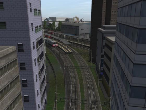 Der Bahnhof Sugomori Minato. Zusehen ist auch der Hafen, der für die Region eine wirtschaftliche wichtige Rolle spielt